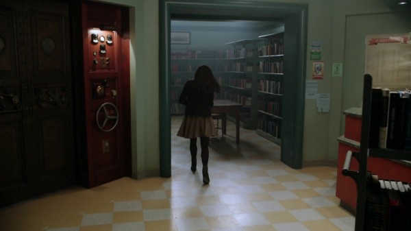 Belle in the library with elevator door (The Outsider-2x11)