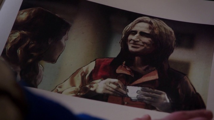 Once Upon a Time 5x05 Dreamcatcher - Merida looking at Rumple and Belle page at the Mayor's office